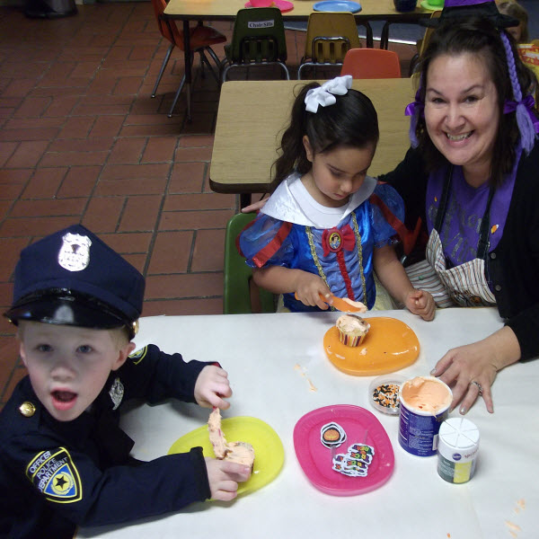 Preschool in Modesto CA | Frosting Cupcakes at Halloween